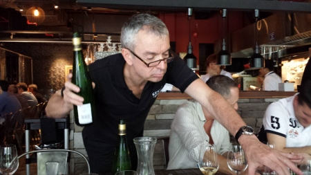 Etienne busy pouring his Jubilee riesling